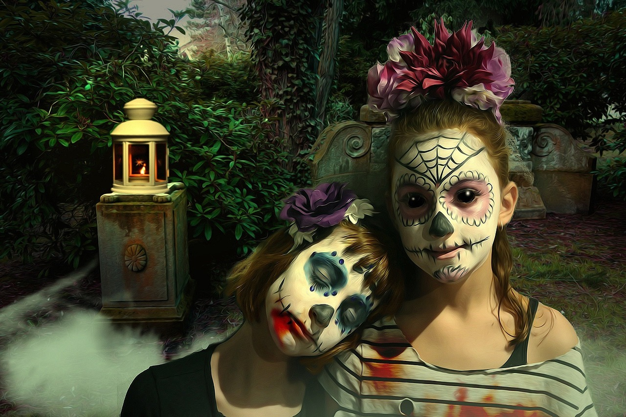 young sisters in day of dead face paint