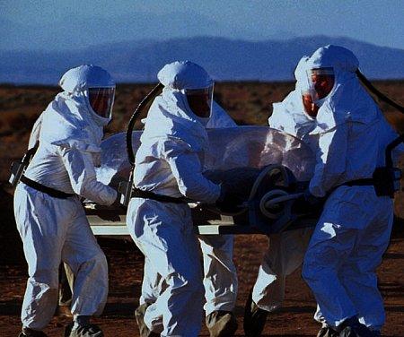 X-Files fight the future - black oil victim, hazmat team
